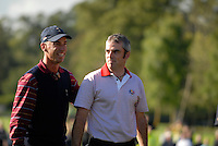 September 24th, 2006. European  Ryder Cup team player Paul McGinley is congratulated by USA Ryder Cup vice captain Corey Pavin after his team won the singles final session of the last day of the 2006 Ryder Cup at the K Club in Straffan,. County Kildare in the Republic of Ireland...Photo: Eoin Clarke/ Newsfile..