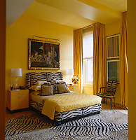 The zebra-print rug and upholstery add an exotic touch to this brigh yellow bedroom