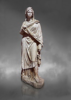 Roman statue of Sabina .Marble. Perge. 2nd century AD. Inv no 3066-3086. Antalya Archaeology Museum; Turkey. Against a grey background
