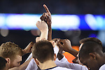 07 April 2014: University of Connecticut players huddle up before tip off against the University of Kentucky during the 2014 NCAA Men's DI Basketball Final Four Championship at AT&T Stadium in Arlington, TX. Connecticut defeated Kentucky 60-54 to win the national title. Peter Lockley/NCAA Photos