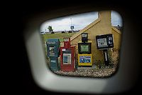 Travel scenes of Wyoming through the window of a rented Mazda M5...Newspaper dispensers in Rawlins, Wyoming.