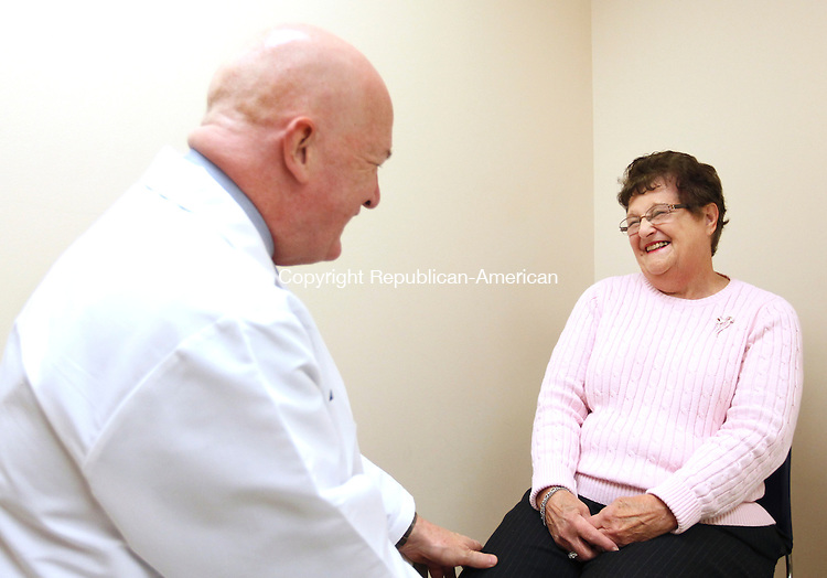 Middlebury, CT-03 November 2011-110311CM01- Dr. David Knight, talks with patient Gloria Demunda of Waterbury, at his office in Middlebury Thursday afternoon.  Dr. Knight was recently named Waterbury Hospital's 'humanitarian of the year'.  Christopher Massa Republican-American