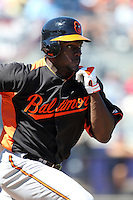 Baltimore Orioles outfielder Xavier Avery #70 runs to first during a spring training game against the Tampa Bay Rays at the Charlotte County Sports Park on March 5, 2012 in Port Charlotte, Florida.  (Mike Janes/Four Seam Images)