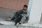Sgt. Luis Cruz, 28, of Davenport, Iowa,  a soldier with Company C, 1st Battalion, 23rd Infantry Regiment, takes a breather after a raid on a mosque believed linked to insurgents in Baqubah, Iraq. More than 10,000 U.S. and Iraqi troops moved into the city last week to clear it of al Qaida and other insurgent fighters. June 27, 2007. DREW BROWN/STARS AND STRIPES