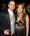Matthew and Jennifer Pesek at the Houston Rockets Tux & Tennies benefit at Toyota Center Thursday March  27,2008. (Dave Rossman/For the Chronicle)