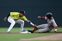 Shortstop Edgardo Fermin (10) of the Columbia Fireflies makes the tag as Ricardo Cubillan (10) of the Greenville Drive is out at second base in a double play in a game on Friday, May 25, 2018, at Spirit Communications Park in Columbia, South Carolina. Columbia won, 3-1. (Tom Priddy/Four Seam Images)
