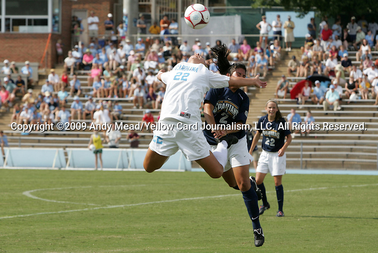 30 August 2009: North Carolina's Amber Brooks (22) and Greensboro's Cat Barnekow (2) challenge for the ball. The University of North Carolina Tar Heels defeated the University of North Carolina Greensboro Spartans 1-0 at Fetzer Field in Chapel Hill, North Carolina in an NCAA Division I Women's college soccer game.