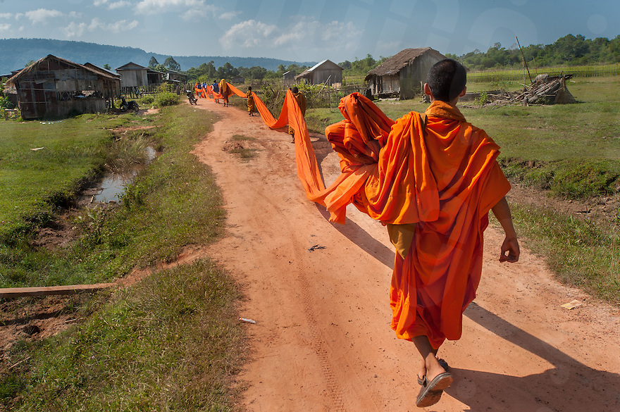 November 03, 2013 - Koh Kong, Cambodia. Monks march through the village of Pra Lay in the Arang Valley hoping to encourage the residents to think criticially about environmental protection. Koh Kong, Cambodia. © Luc Forsyth / Ruom