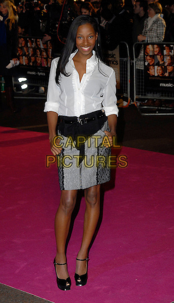 "JAMELIA.Attends the UK Premiere of ""Music & Lyrics"",.Odeon Leicester Square, .London, England, February 5th 2006..full length white shirt grey and black skirt shoes belt hands in pockets.CAP/CAN.©Can Nguyen/Capital Pictures"