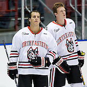 Drew Ellement (Northeastern - 2), Josh Manson (Northeastern - 3) - The visiting St. Francis Xavier University X-Men defeated the Northeastern University Huskies 8-5 on Sunday, October 2, 2011, at Matthews Arena in Boston, Massachusetts.