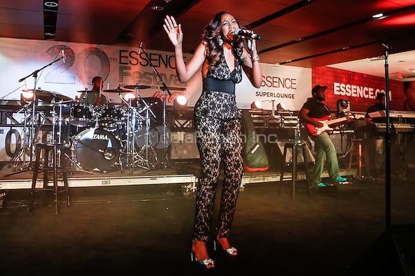 NEW ORLEANS - JULY 4: Greta Prince performs in the Essence Superlounge at the 2014 Essence Festival at the Superdome in New Orleans, Louisiana on July 4, 2014. Credit: PGHingle/MediaPunch
