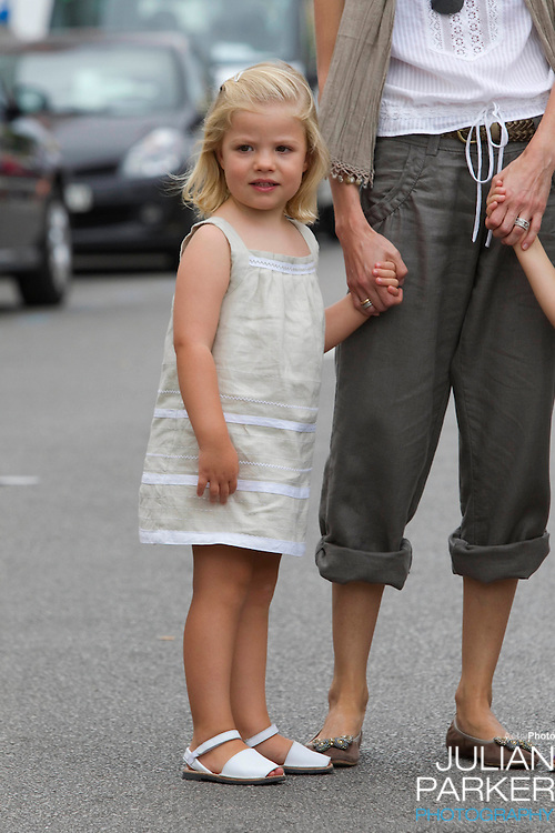 Crown Princess Letizia, and daughters Princess Leonor, and Princess Sofia, arrive at The Royal Yacht Club, in Palma, Mallorca, to meet.Crown Prince Felipe after he  competed  in the second day of the Copa Del Rey sailing regatta..( Princess Sofia in Picture )