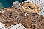 Milne Bay, Papua New Guinea; Tawali Resort, coiled ropes on main dock , Copyright © Matthew Meier, matthewmeierphoto.com