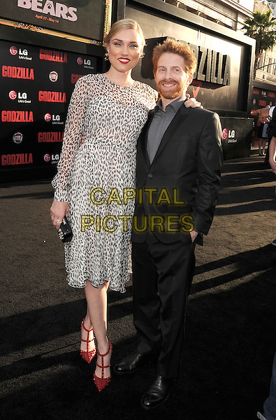 HOLLYWOOD, CA- MAY 08: Actor Seth Green (R) and actress Clare Grant arrive at the Los Angeles premiere of 'Godzilla' at Dolby Theatre on May 8, 2014 in Hollywood, California.<br /> CAP/ROT/TM<br /> &copy;Tony Michaels/Roth Stock/Capital Pictures