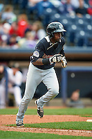 New Britain Rock Cats second baseman Juan Ciriaco (2) runs to first during a game against the Akron RubberDucks on May 21, 2015 at Canal Park in Akron, Ohio.  Akron defeated New Britain 4-2.  (Mike Janes/Four Seam Images)