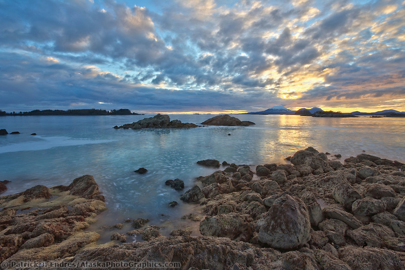 View of mountEdgecumbe across Sitka Sound at sunset, Herring eggs cover the beach in the foreground, Southeast, Alaska.