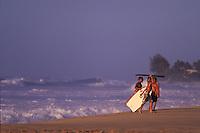 Keiki Bodyboarders in the winter evening at Ehukai Beach