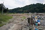 Photo shows vacant land, once the site of a thriving fishing community near Kyubun beach on the Oshika Peninsula, Ishinomaki City, Miyagi Prefecture, Japan on 10 Sept, 2011, 6 months after the mega-tsunami ripped through the area..Photographer: Robert Gilhooly