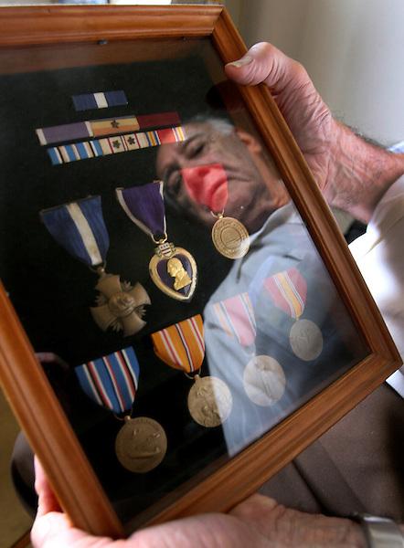 X.veterans.2.0524.jl.jpg/photo Jamie Scott Lytle/Joe Marquez of Oceanside, a WWII Veteran and a Navy Cross recipient amoung other medals.