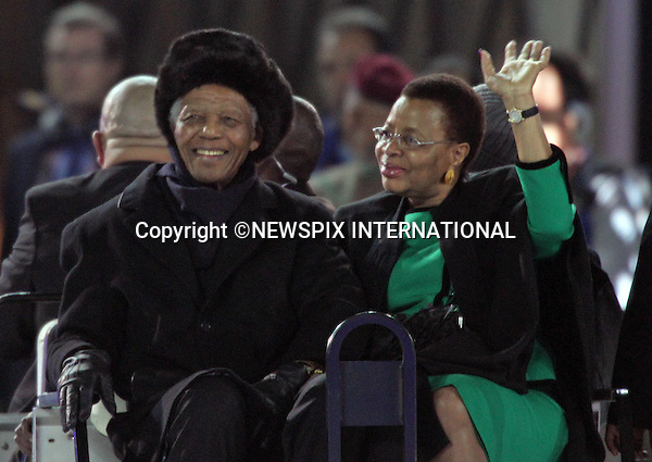 """NELSON MANDELA AND WIFE GRACA MACHEL.the former South African President at the FIFA World Cup 2010 Final, Soccer City Johannesburg South Africa_11/07/2010  .Mandatory Credit Photos: ©Newspix International..**ALL FEES PAYABLE TO: """"NEWSPIX INTERNATIONAL""""**..PHOTO CREDIT MANDATORY!!: NEWSPIX INTERNATIONAL(Failure to credit will incur a surcharge of 100% of reproduction fees)..IMMEDIATE CONFIRMATION OF USAGE REQUIRED:.Newspix International, 31 Chinnery Hill, Bishop's Stortford, ENGLAND CM23 3PS.Tel:+441279 324672  ; Fax: +441279656877.Mobile:  0777568 1153.e-mail: info@newspixinternational.co.uk"""