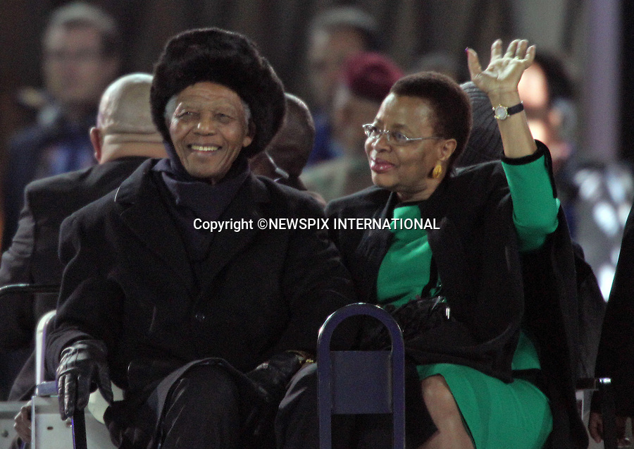 "NELSON MANDELA AND WIFE GRACA MACHEL.the former South African President at the FIFA World Cup 2010 Final, Soccer City Johannesburg South Africa_11/07/2010  .Mandatory Credit Photos: ©Newspix International..**ALL FEES PAYABLE TO: ""NEWSPIX INTERNATIONAL""**..PHOTO CREDIT MANDATORY!!: NEWSPIX INTERNATIONAL(Failure to credit will incur a surcharge of 100% of reproduction fees)..IMMEDIATE CONFIRMATION OF USAGE REQUIRED:.Newspix International, 31 Chinnery Hill, Bishop's Stortford, ENGLAND CM23 3PS.Tel:+441279 324672  ; Fax: +441279656877.Mobile:  0777568 1153.e-mail: info@newspixinternational.co.uk"