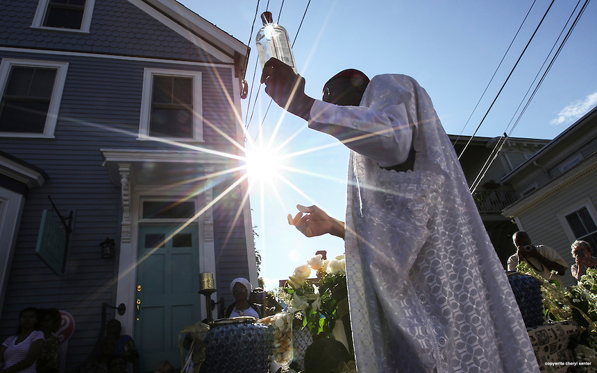 Portsmouth N.H., Sunday, Aug. 17, 2014:  Chief Oscar Ogugua Mokeme performs a consecration ritual on Chestnut Street blessing the slave burial ground.  Members of the African Burying Ground Memorial committee held a ceremony to consecrate the the site. (Portsmouth Herald Photo Cheryl Senter)