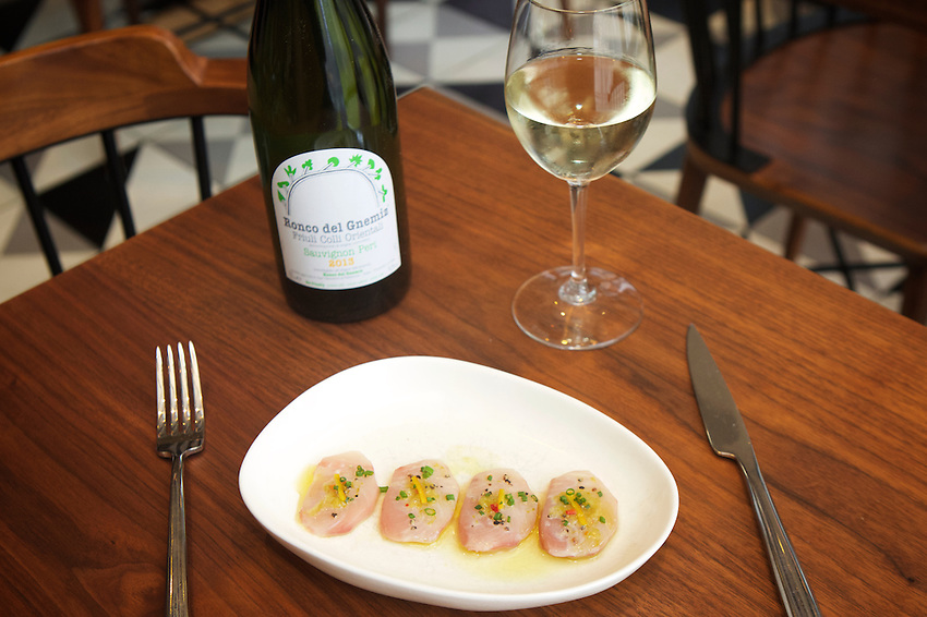 New York, NY - May 17, 2016: Yellowtail Crudo at Laurent Tourondel's L'Amico by chef Larry Baldwin in the Eventi Hotel in Midtown South.<br /> <br /> CREDIT: Clay Williams for Haute Life.<br /> <br /> &copy; Clay Williams / claywilliamsphoto.com