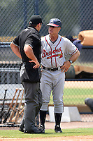 GCL Braves hitting coach Rick Albert (16) argues a call with umpire Jason Johnson during the second game of a doubleheader against the GCL Yankees 1 on July 1, 2014 at the Yankees Minor League Complex in Tampa, Florida.  GCL Braves defeated the GCL Yankees 1 by a score of 3-1.  (Mike Janes/Four Seam Images)