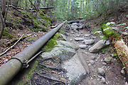 Piping along the Crawford Path, near Gibbs Brook, in the New Hampshire White Mountains. This piping system and dam (out of sight) supplied water to the old Crawford House. The Crawford House was located where the AMC Highland Center is today. The Crawford Path is the oldest continuously used mountain trail in America, passes by this dam.