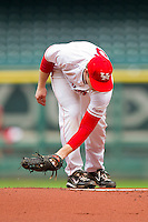 Starting pitcher Codey Morehouse #5 of the Houston Cougars cleans off the pitching rubber during a game against the Baylor Bears at Minute Maid Park on March 4, 2011 in Houston, Texas.  Photo by Brian Westerholt / Four Seam Images