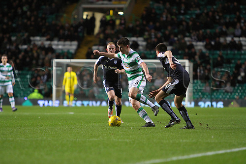 02.03.2016. Celtic Park, Glasgow, Scotland. Scottish Premier League. Celtic versus Dundee. Kieran Tierney tries to find a way through between Dundees Nicky Low and Cammy Keer