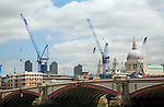View north east over Blackfriars Bridge towards St Paul's cathedral showing large cranes working on construction projects, London
