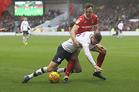 Preston North End's Louis Moult battles with  Nottingham Forest's Matty Cash<br /> <br /> Photographer Mick Walker/CameraSport<br /> <br /> The EFL Sky Bet Championship - Nottingham Forest v Preston North End - Saturday 8th December 2018 - The City Ground - Nottingham<br /> <br /> World Copyright © 2018 CameraSport. All rights reserved. 43 Linden Ave. Countesthorpe. Leicester. England. LE8 5PG - Tel: +44 (0) 116 277 4147 - admin@camerasport.com - www.camerasport.com