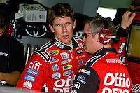 14-16 November 2008, Homestead, Florida USA.Championship contender Carl Edwards talks with his crew chief in the garage during practice..©F.Peirce Williams 2008.F. Peirce Williams.photography.ref: Capture via Nikon .NEF (RAW) & .JPG