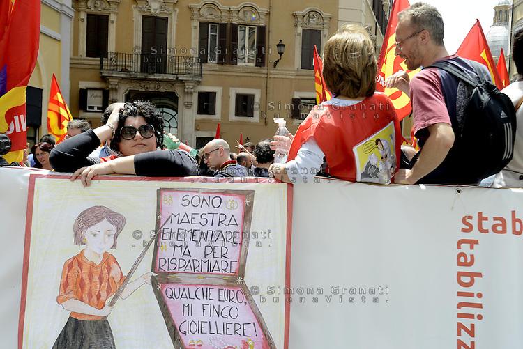 Roma, 22 Maggio 2013.Piazza Montecitorio.Manifestazione USB dei lavoratori e delle lavoratrici del Pubblico Impiego per il rinnovo del contratto, la stabilizzazione dei precari, contro la Riforma Brunetta