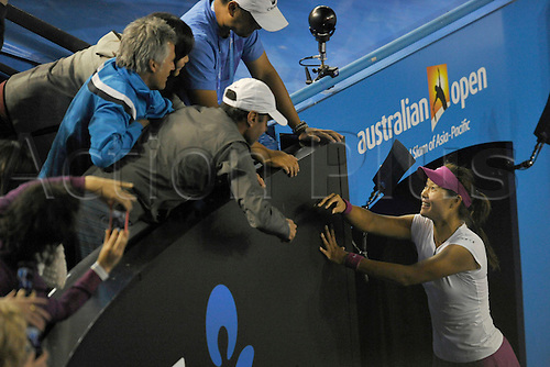 25.01.2014 Melbourne, Australia. Li Na of China celebrates after her victory against Dominika Cibulkova of Slovakia in the ladies singles final on day thirteenth of the Australian Open from Melbourne Park. Li Na powered to the title by a score of 7-6 (7-3) 6-0.