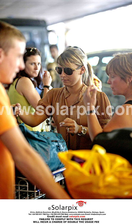 ALL ROUND PICTURES FROM SOLARPIX.COM.*MUST CREDIT SOLARPIX.COM OR DOUBLE USAGE FEE*.**NO PUBLICATION IN FRANCE, SCANDANAVIA, AUSTRALIA AND GERMANY PUBLICATION IN UK MAGS ONLY**.Footballers wives and girlfriends arrive in Germany for the start of the World Cup 2006 - 09.06.06.Picture shows: Wayne Rooney's girlfriend Coleen McLoughlin arriving at Frankfurt airport today.REF:  2473 SFE