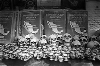 Skulls and booklets of the Mexican Political Constitution for sale at a magazine stand in the City's center.