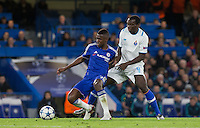 Ramires of Chelsea & Vincent Aboubakar of FC Porto battle for the ball during the UEFA Champions League group G match between Chelsea and FC Porto at Stamford Bridge, London, England on 9 December 2015. Photo by Andy Rowland.