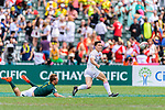 Heino Bezuidenhout of South Africa (L) tries to catch Callum Sirker of England (R) during the HSBC Hong Kong Sevens 2018 match between South Africa and England on April 7, 2018 in Hong Kong, Hong Kong. Photo by Marcio Rodrigo Machado / Power Sport Images