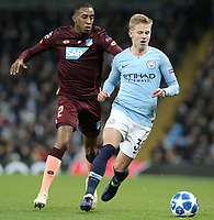 Manchester City's Oleksandr Zinchenko under pressure from 1899 Hoffenheim's Joshua Brenet<br /> <br /> Photographer Rich Linley/CameraSport<br /> <br /> UEFA Champions League Group F - Manchester City v TSG 1899 Hoffenheim - Wednesday 12th December 2018 - The Etihad - Manchester<br />  <br /> World Copyright © 2018 CameraSport. All rights reserved. 43 Linden Ave. Countesthorpe. Leicester. England. LE8 5PG - Tel: +44 (0) 116 277 4147 - admin@camerasport.com - www.camerasport.com