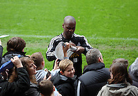 Wednesday, 23 April 2014<br /> Pictured: Leroy Lita signing autographs for supporters.<br /> Re: Swansea City FC are holding an open training session for their supporters at the Liberty Stadium, south Wales,