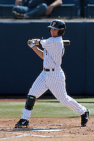 Richy Pedroza #6 of the Cal State Fullerton Titans bats against the TCU Horned Frogs at Goodwin Field on February 26, 2012 in Fullerton,California. Fullerton defeated TCU 11-10.(Larry Goren/Four Seam Images)