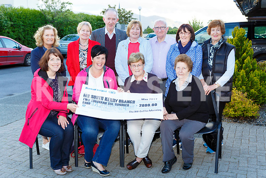 Tara O'Donoghue and Ann Marie O'Leary presents the proceeds of their coffee morning held in the Royal Hotel on April 21st to the MS South Kerry Branch on Tuesday evening front row l-r: Tara O'Donoghue, Ann Marie O'Leary, Rosemary Nolan, Kathleen O'Shea. Back row: Mary O'Connor, Kay Fleming, Kathleen Sheehan, Pat O'Neilll, Noreen Piggot, Norrie O'Neill