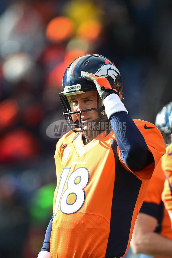 Jan 12, 2013; Denver, CO, USA; Denver Broncos quarterback Peyton Manning (18) salutes prior to the game against the Baltimore Ravens during the AFC divisional round playoff game at Sports Authority Field.  Mandatory Credit: Mark J. Rebilas-