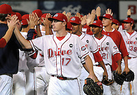 Sept. 17, 2009: Greenville Drive players high-five each other after beating Lakewood 3-2 in Game 3 of the South Atlantic League Championship Series between the Greenville Drive and the Lakewood BlueClaws Sept. 17, 2009, at Fluor Field at the West End in Greenville, S.C.  Photo by: Tom Priddy/Four Seam Images