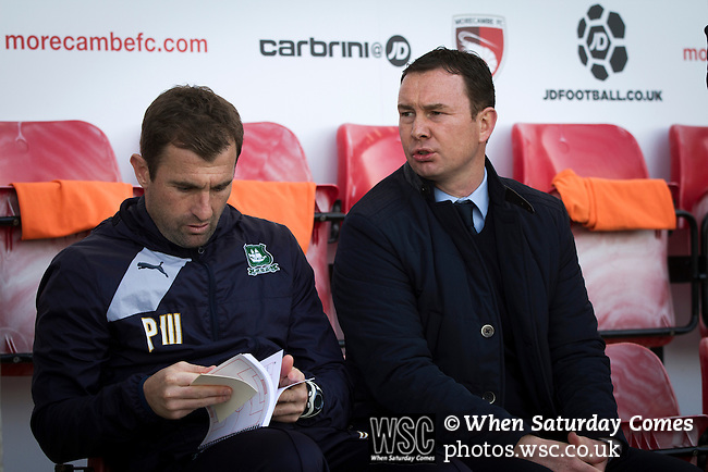 Morecambe 0 Plymouth Argyle 2, 25/03/2016. Globe Arena, League 2. Visiting manager Derek Adams (right) and first team coach Paul Wotton taking their seats at the Globe Arena before Morecambe hosted Plymouth Argyle in a League 2 fixture. The stadium was opened in 2010 and replaced Morecambe's traditional home of Christie Park which had been their home since 1921, the year after their foundation. Plymouth won this fixture by 2-0 watched by 2,081 spectators, in a game delayed by 30 minutes due to traffic congestion affecting travelling Argyle fans. Photo by Colin McPherson.