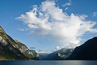 Mountains rise from the waters of Sognefjord, Norway
