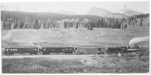 RGS #12 with train returning from &quot;Silver Spike&quot; celebration in Rico with Lizard Head Peak on skyline.<br /> RGS  Lizard Head, CO  Taken by Carpenter, W. J. - or 1892 10/15/1891