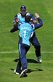 Cricket - ODI Summer Tri-Series - Scotland V Sri Lanka at Grange CC - Edinburgh - Scotland bowler Preston Mommsen goes to his Capt (Gordon Drummond) to celebrate one of his two wickets - Picture by Donald MacLeod - 13.07.11 - 07702 319 738 - www.donald-macleod.com